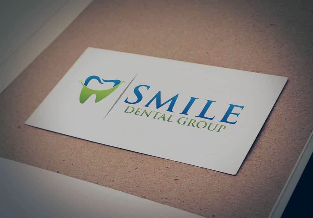 smile dental logo design jumptoweb